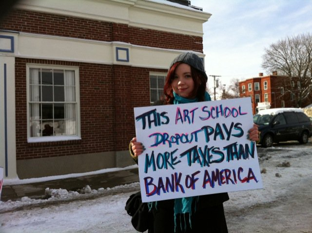 CORP WOLF PAC BANGK OF AMERICA PROTEST Sign Art School Dropout pays more that Bank of America